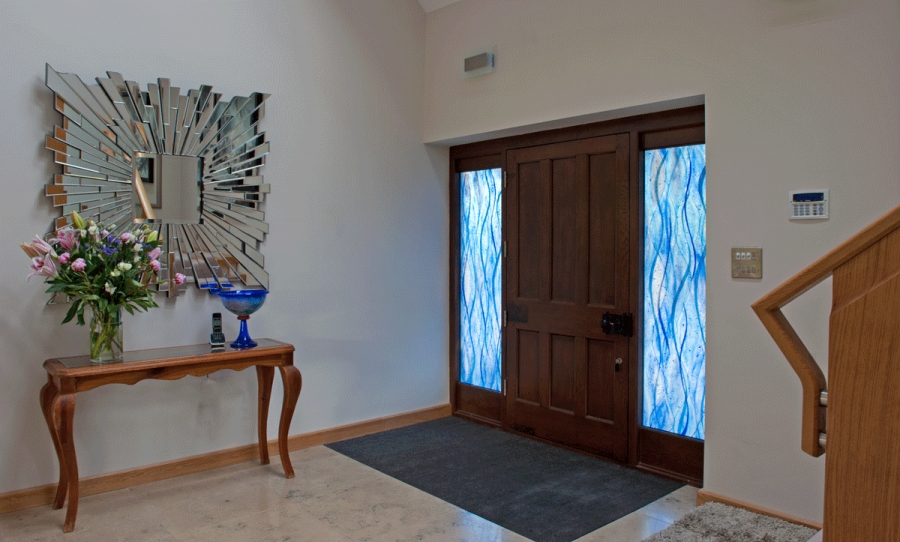 These fused glass windows in East Sussex feature a beautiful blue waterfall design.