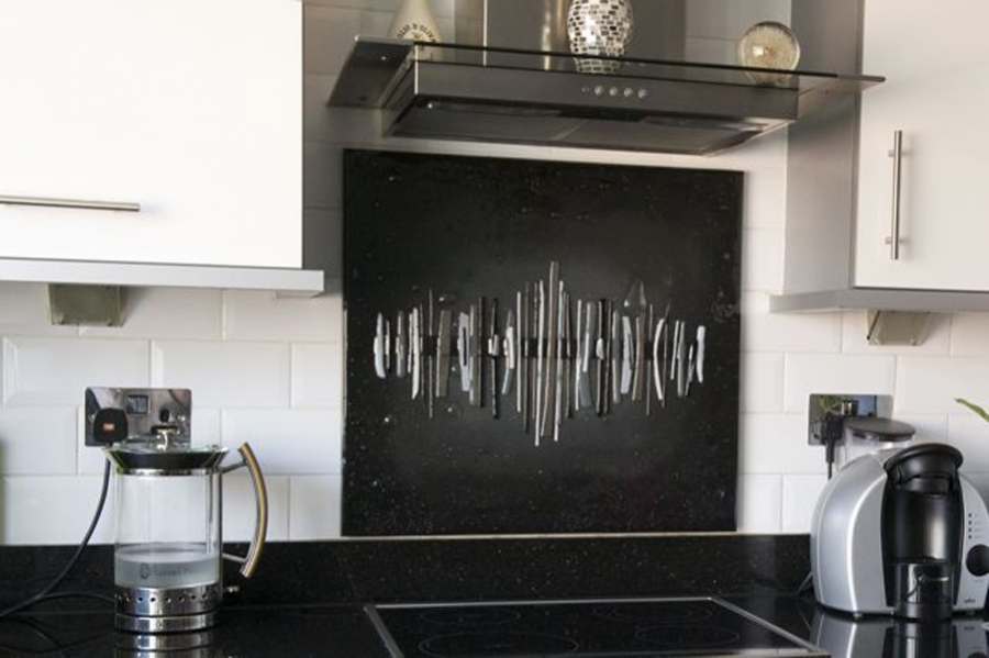 A beautiful example of our glass splashbacks Manchester-wide, in a black and white dalaman style.