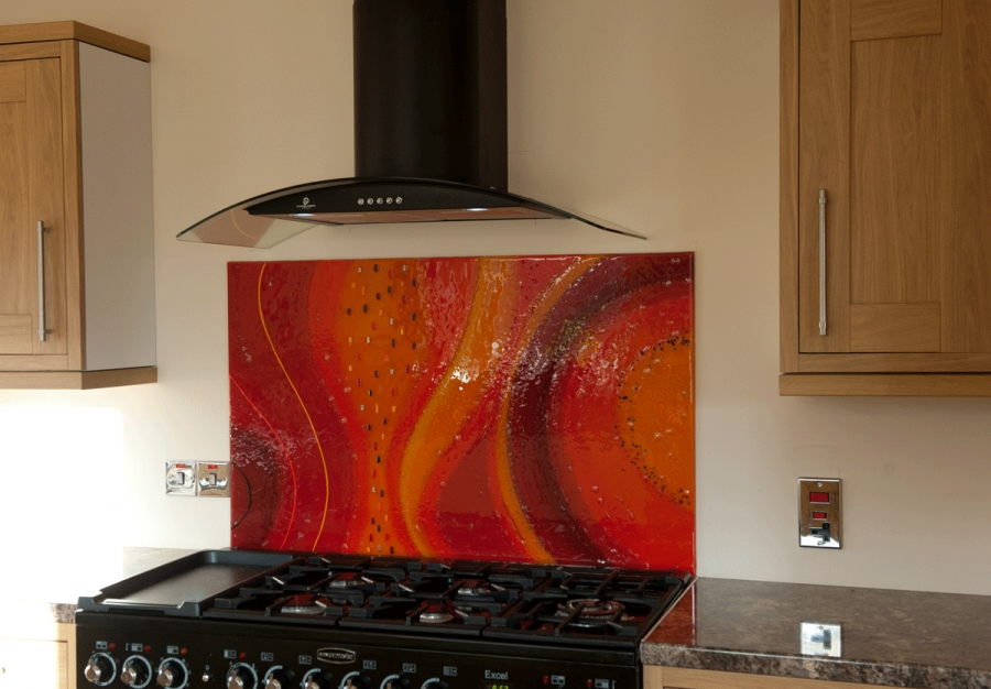 A picture of a fiery example of one of our glass splashbacks Scotland-wide.