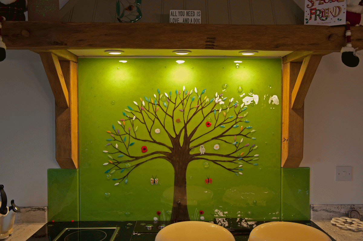 This beautifully green tree of life is the perfect example of what our glass splashbacks can do for your kitchen.