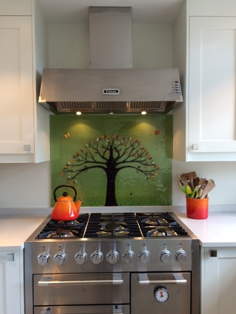 This gorgeous fused glass art is another tree of life design, with an olive green background and orange highlights