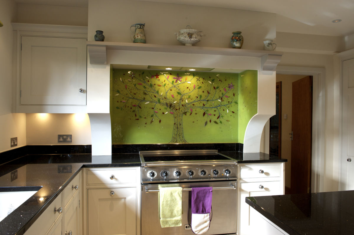 This is a picture of a beautiful, bespoke fused glass splashback in green. A classic design for us.