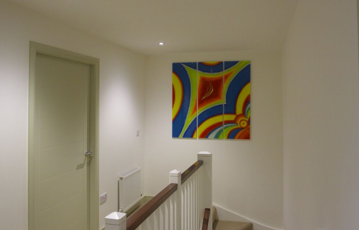This vibrant bespoke fused glass art is a piece mounted on the wall in Ayr, Scotland. It's a beautiful work, we think!