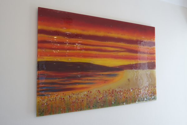 An image of bespoke fused glass art Chelmsford, burning bright and orange.