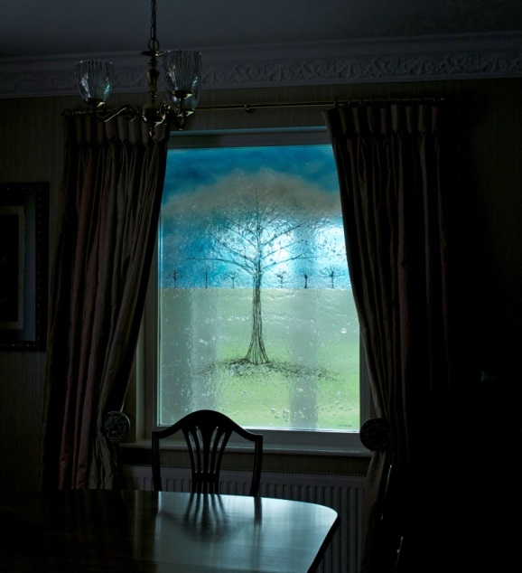 A gorgeous fused glass window with a tree sitting front and centre. We love how light shines through!