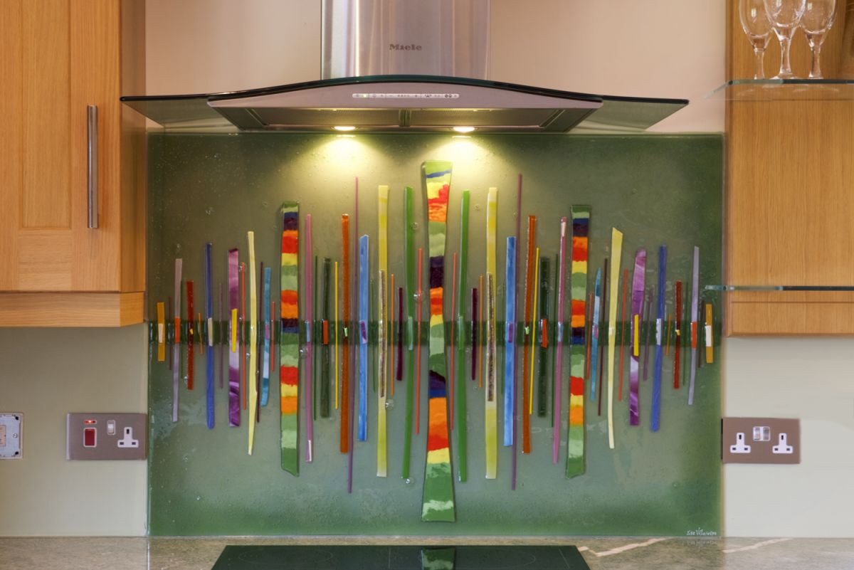 A gorgeous example of our bespoke fused glass splashbacks. We particularly love the use of colour on this Dalaman!