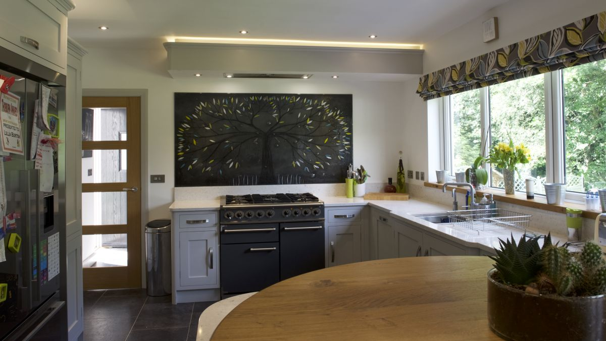 This gorgeously black fused glass art design sits above a cooker and really stands out!