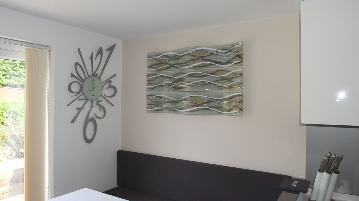 This gorgeous three panel piece is the perfect example of how glass wall art can add something spectacular to a room.