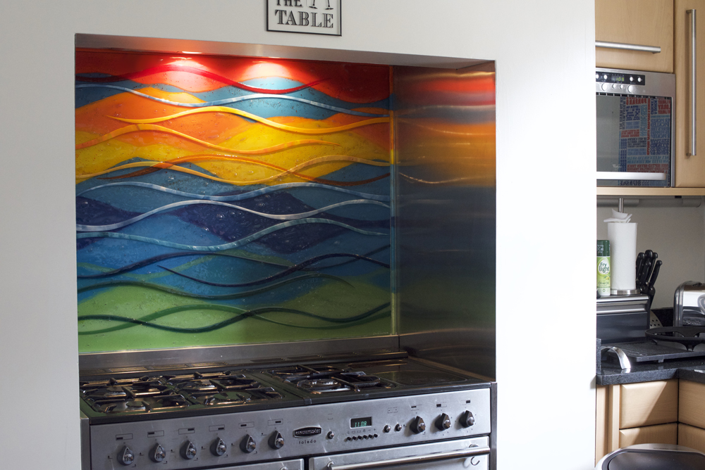 This gorgeous piece of fused glass art found a place in Bradford. It's definitely a colourful feature!