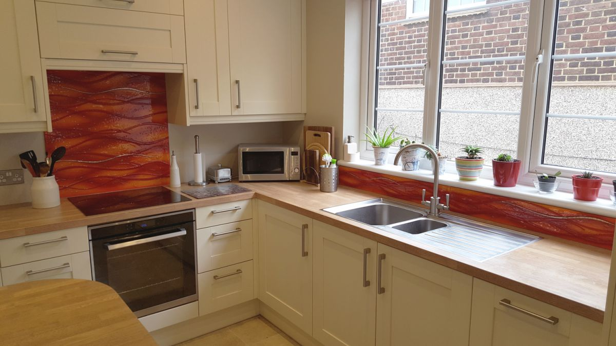 One of our trademark bespoke glass splashbacks created in a vividly warm palette and installed in Kent.