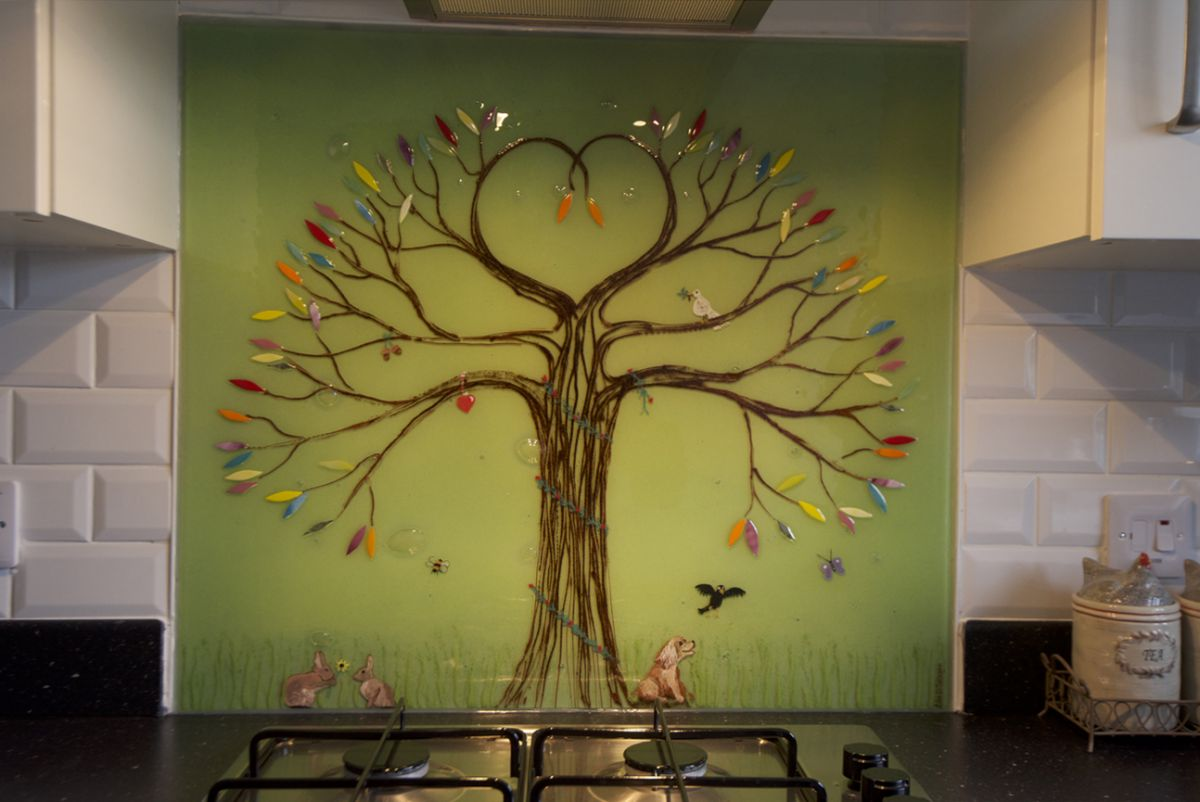 This is a splashback in Aylesbury that we created. It's a tree of life design made from fused glass art.