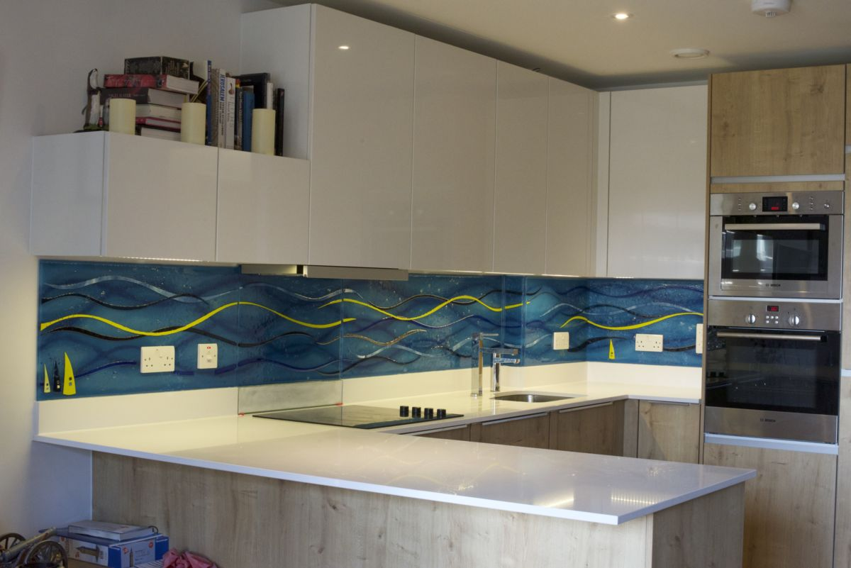 This is one of our incredibly versatile bespoke glass splashbacks. This one is rather aquatic, don't you think?