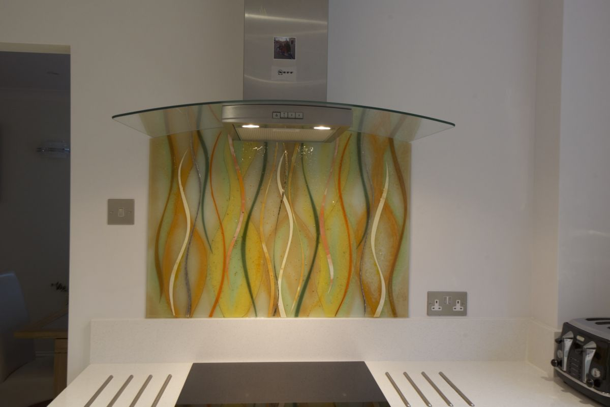 A gorgeous example of a bespoke fused glass kitchen splashback against modern styling.