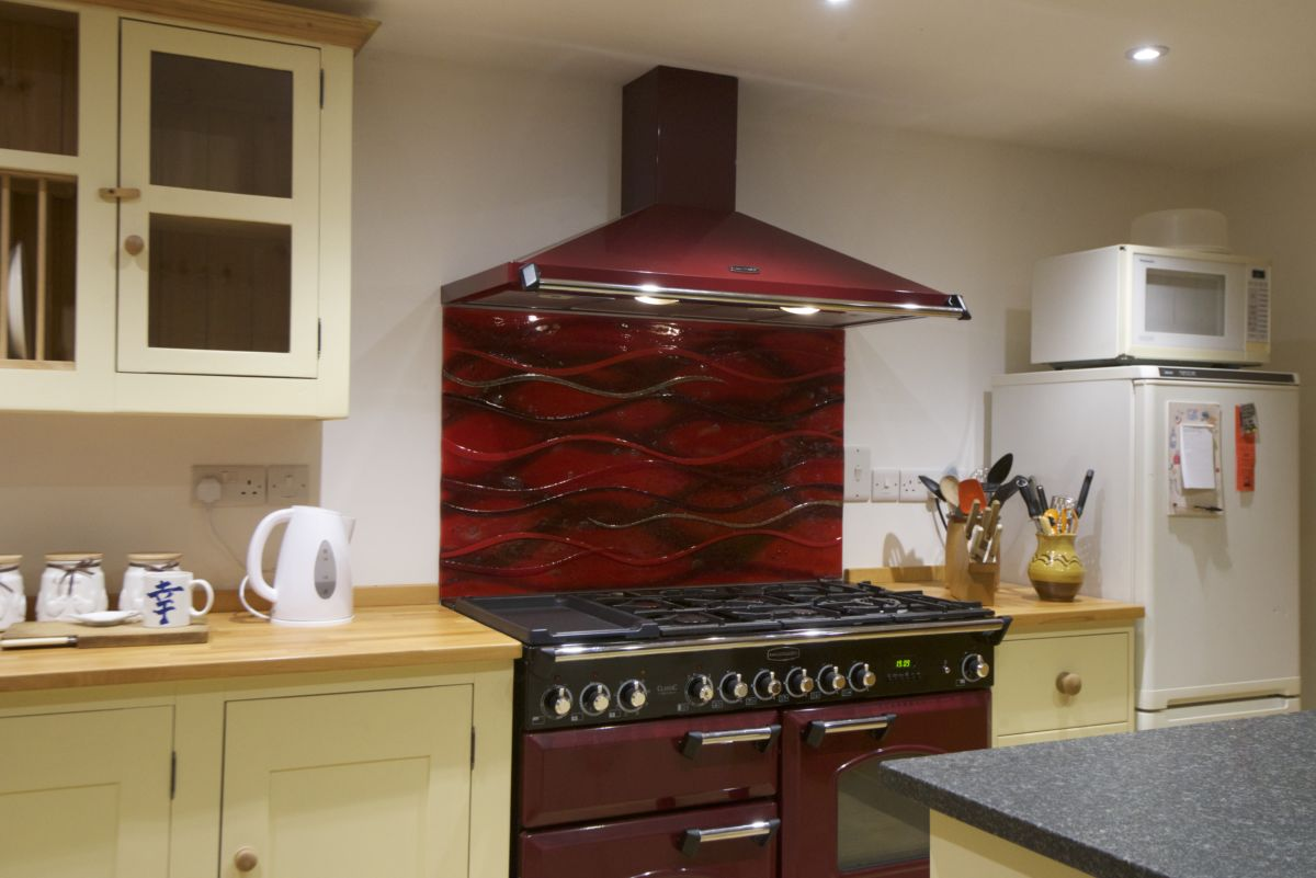 One of our gorgeous bespoke fused glass kitchen splashbacks, delivered and installed in Langford, Somerset.