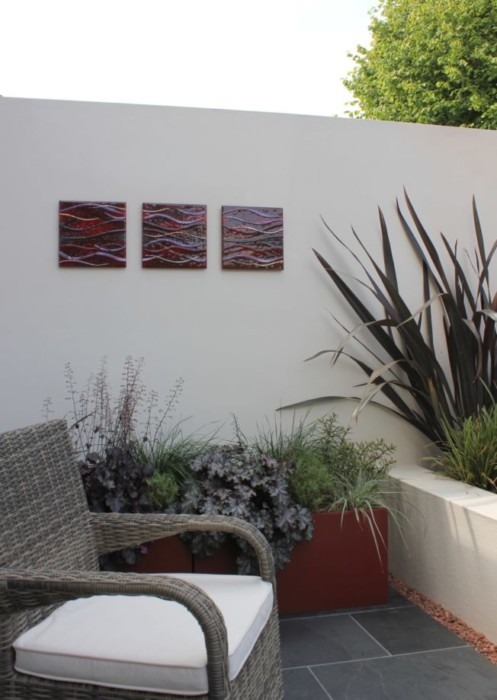 A picture of a recently completed fused glass art installation, showing just how gorgeous our work can be when displayed in an outdoors environment.