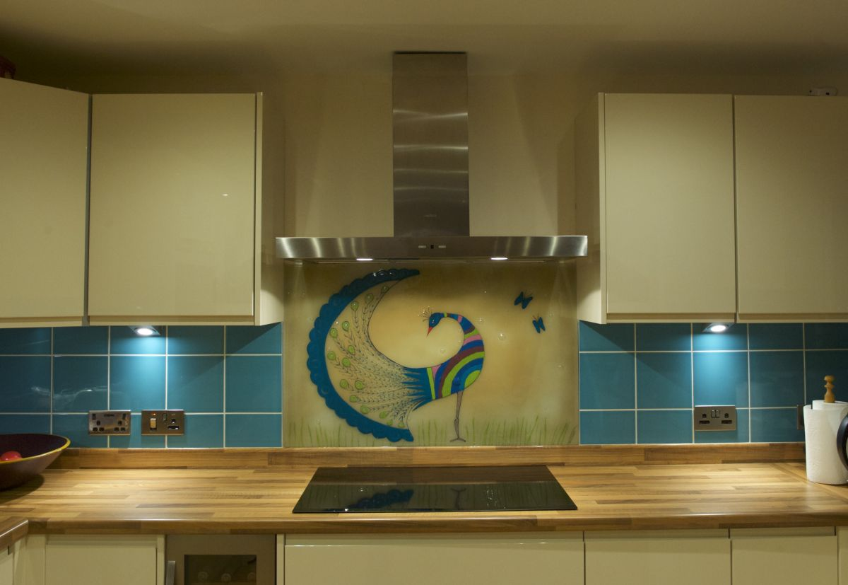 A beautiful piece of bespoke fused glass art with a peacock design. A sublime splashback!