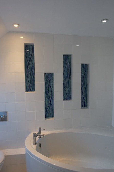 A gorgeous example of our fused glass wall art UK-wide, displayed here in a bathroom. The windows go two ways!