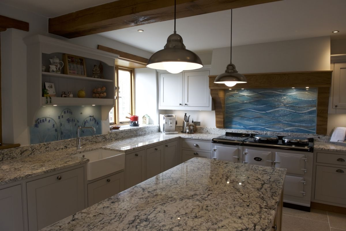 Coloured glass splashbacks are a thing of the past. Fused glass art can have an absolutely stunning effect in any kitchen.
