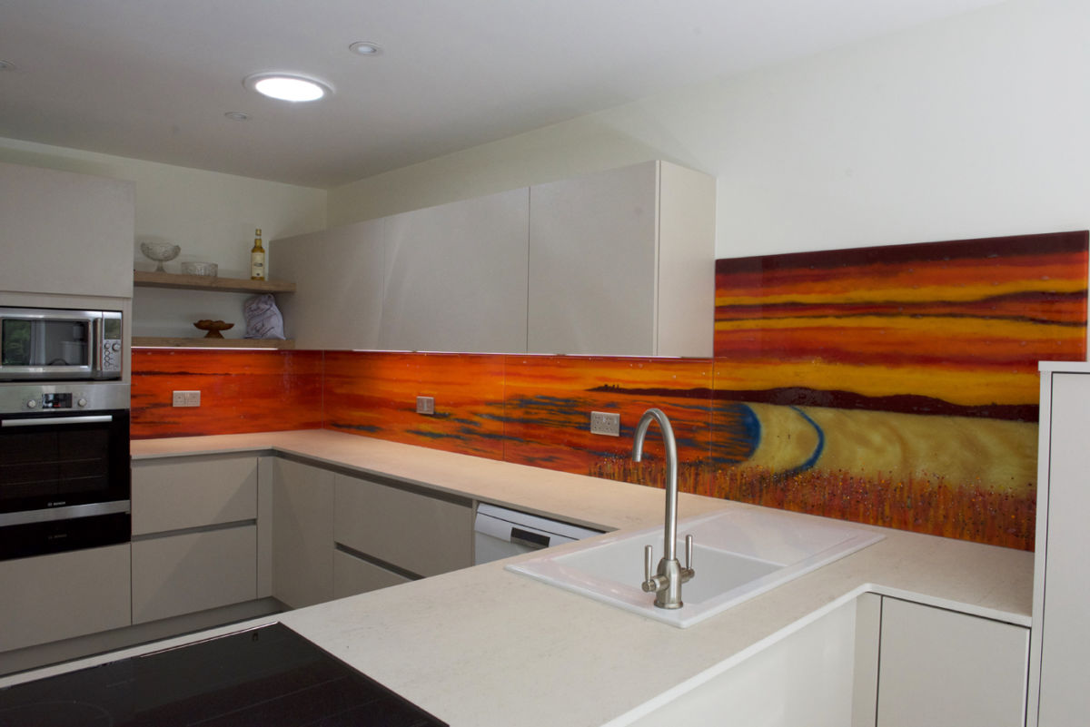 A gorgeous fused glass art installation with warm, welcoming hues!