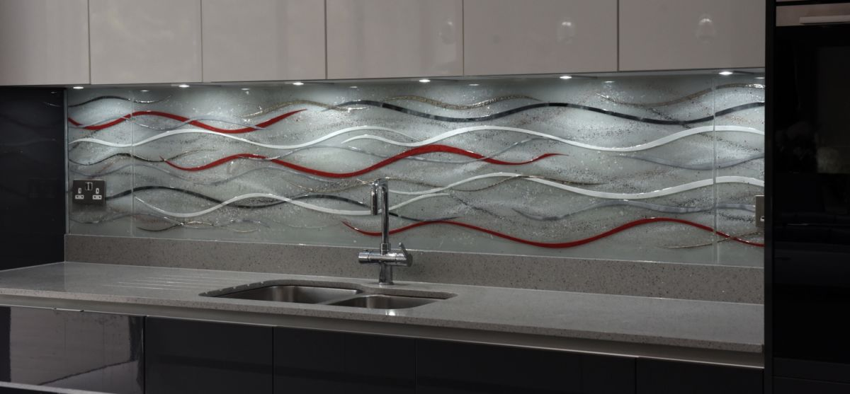 This is a picture of a fused glass art splashback which recently found a home in Essex. A beautiful wave design.